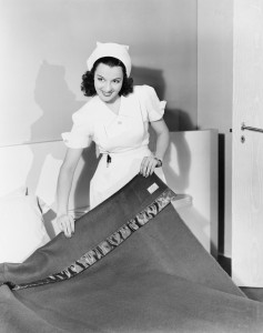 vintage-nurse-making-bed-237x300